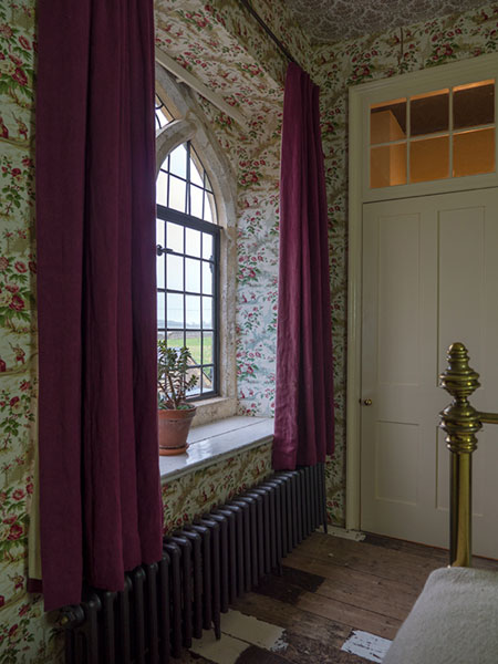 Dark red hand died linen curtains in a Somerset Farmhouse designed by Luis Laplace