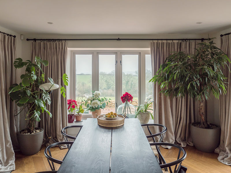 Stunning dining room with full length natural linen curtains