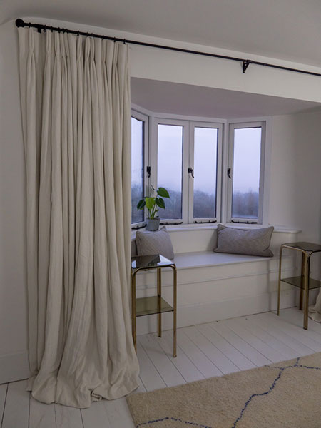 Extra long linen curtains with pooling design for a luxurious finish