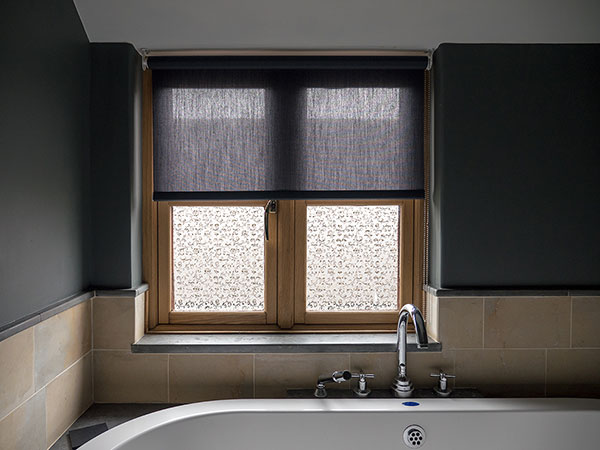 A bathroom roller blind made to measure for a cottage in Bruton