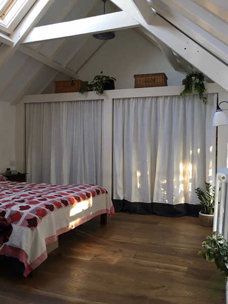 Built in wardrobes with curtained doors for a soft and calming look for the bedroom. Shown with the curtains drawn closed.