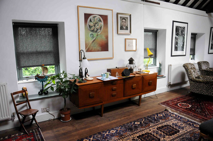 An eclectic, modern yet rustic country cottage lounge with ethnic influences, the home of an artist in Somerset