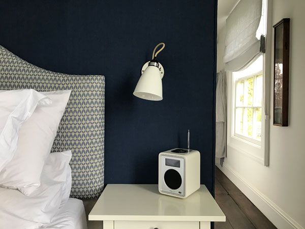 A fabric covered wall and handmade fabric headboard made by No Naked Windows of Bruton, Somerset