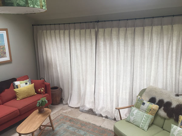 Unlined linen curtins let natural light through for privacy and a soft glow during the day