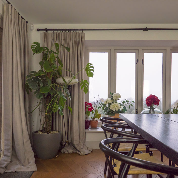 Full length pooling curtains in a farmhouse kitchen diner in Somerset