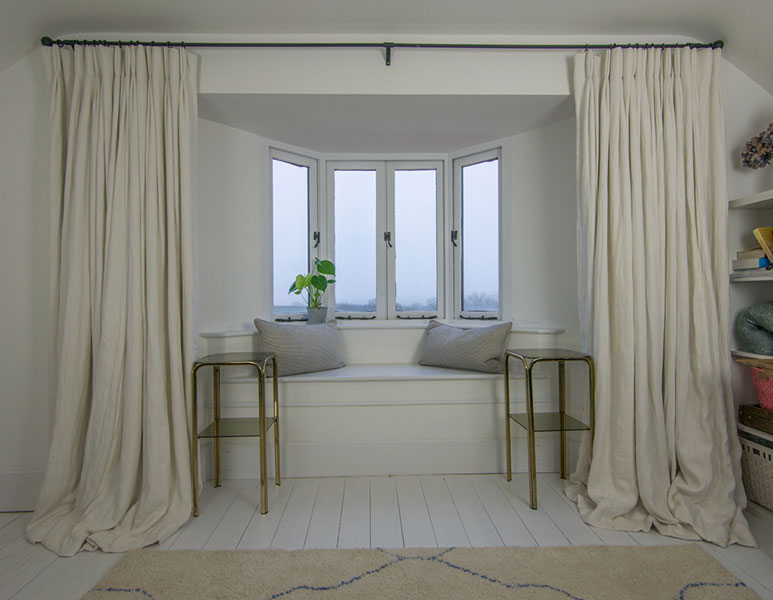 Stunning extra long white linen curtains in the office/yoga room of a country farmhouse in Somerset