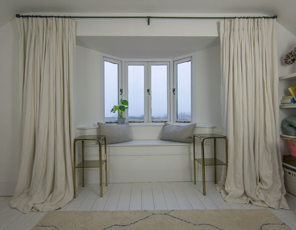 Beautiful extra long pooling linen curtains in pale soft off white