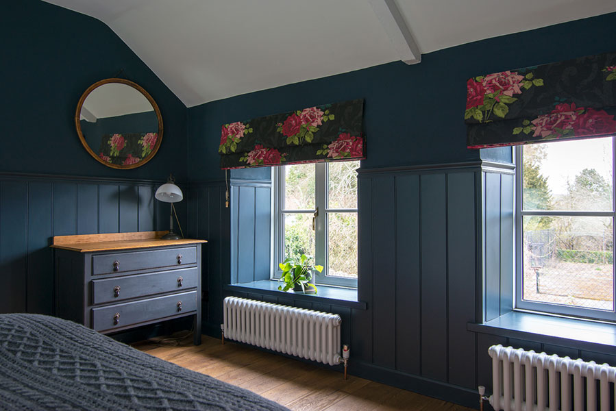 Handmade made to measure Roman blinds made from stunning dark grey cotton with a rose fabric by Osborne & Little.
