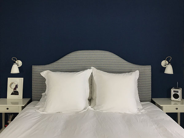 Hand made upholstered headboard with blue and white geometric pattern