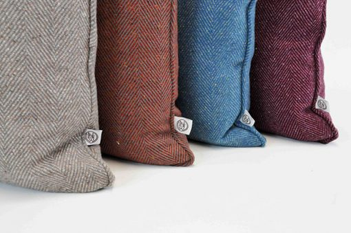 Pure wool tweed handmade cushions available in many colours showing Azure, Stone, Rust and Damson